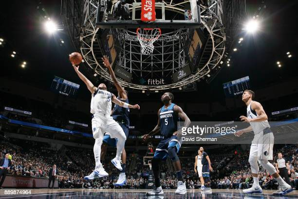 J Barea of the Dallas Mavericks handles the ball against the Minnesota Timberwolves on December 10 2017 at Target Center in Minneapolis Minnesota...
