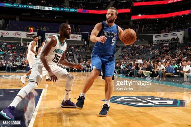 J Barea of the Dallas Mavericks hanldes the ball against the Charlotte Hornets on October 13 2017 at Spectrum Center in Charlotte North Carolina NOTE...