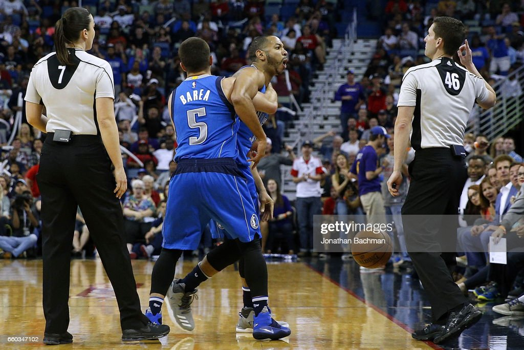 J.J. Barea #5 of the Dallas Mavericks holds back Devin Harris #34 as he is ejected by referee Ben Taylor #46 during the first half of a game against the New Orleans Pelicans at the Smoothie King Center on March 29, 2017 in New Orleans, Louisiana.