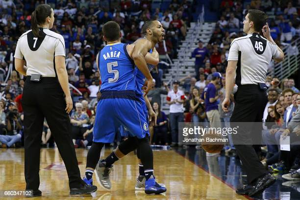 J Barea of the Dallas Mavericks holds back Devin Harris as he is ejected by referee Ben Taylor during the first half of a game against the New...