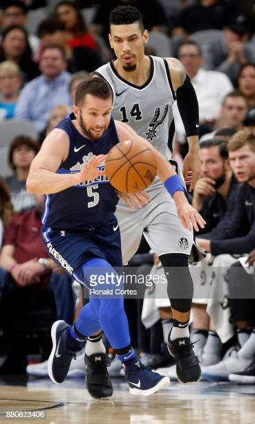 J Barea of the Dallas Mavericks makes a steal in front of Danny Green of the San Antonio Spurs at ATT Center on November 27 2017 in San Antonio Texas...