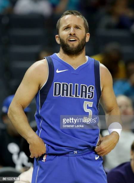 J Barea of the Dallas Mavericks reacts after a play against the Charlotte Hornets during their game at Spectrum Center on October 13 2017 in...