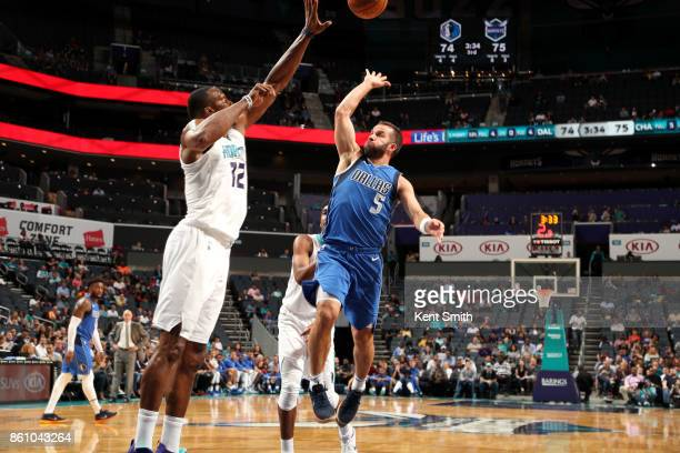 J Barea of the Dallas Mavericks shoots the ball against the Charlotte Hornets on October 13 2017 at Spectrum Center in Charlotte North Carolina NOTE...