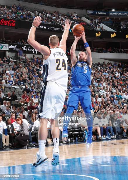 J Barea of the Dallas Mavericks shoots the ball against the Denver Nuggets on December 4 2017 at the American Airlines Center in Dallas Texas NOTE TO...