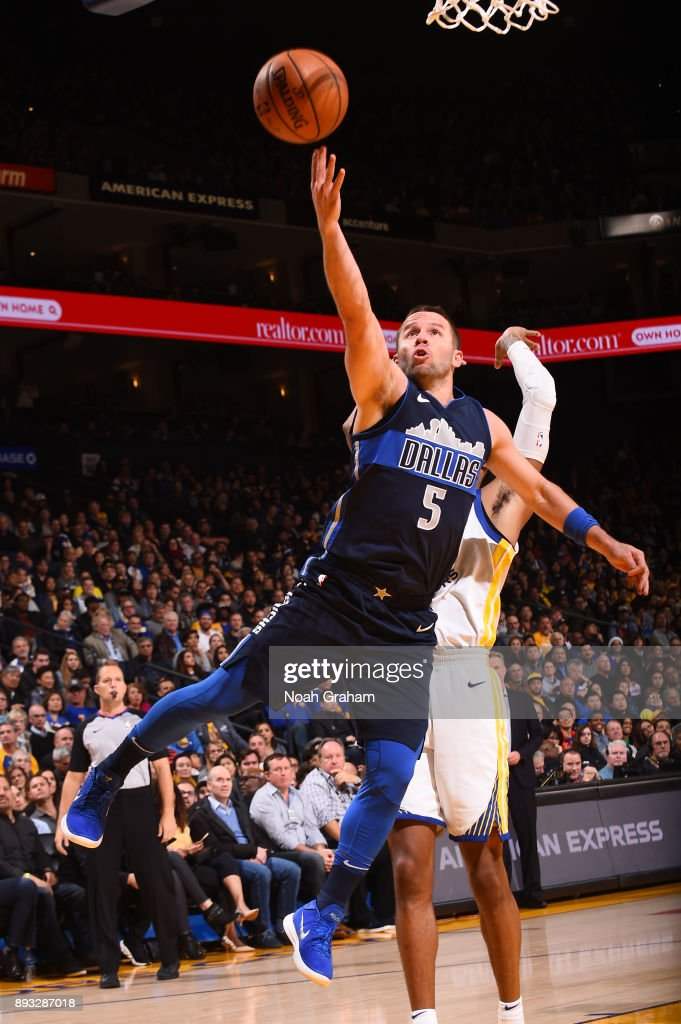 J.J. Barea #5 of the Dallas Mavericks shoots the ball against the Golden State Warriors on December 14, 2017 at ORACLE Arena in Oakland, California.