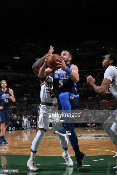 JJ Barea of the Dallas Mavericks shoots the ball against the Milwaukee Bucks on December 8 2017 at the Bradley Center in Milwaukee Wisconsin NOTE TO...