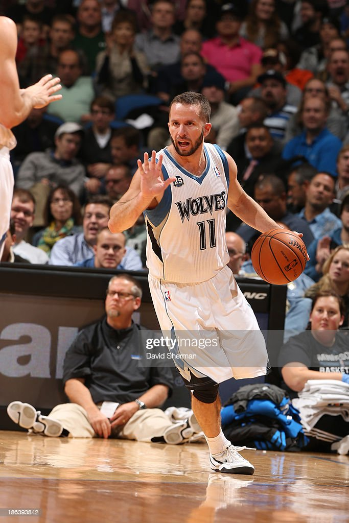 J.J. Barea #11 of the Minnesota Timberwolves brings the ball up court against the Orlando Magic during the season and home opening game on October 30, 2013 at Target Center in Minneapolis, Minnesota.