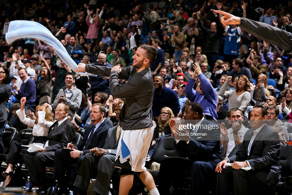 J.J. Barea #11 of the Minnesota Timberwolves celebrates from the bench after teammate Ricky Rubio #9 scored against the San Antonio Spurs on March 12, 2013 at Target Center in Minneapolis, Minnesota.