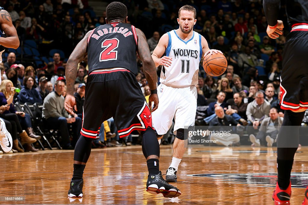 J.J. Barea #11 of the Minnesota Timberwolves controls the ball against Nate Robinson #2 of the Chicago Bulls on March 24, 2013 at Target Center in Minneapolis, Minnesota.