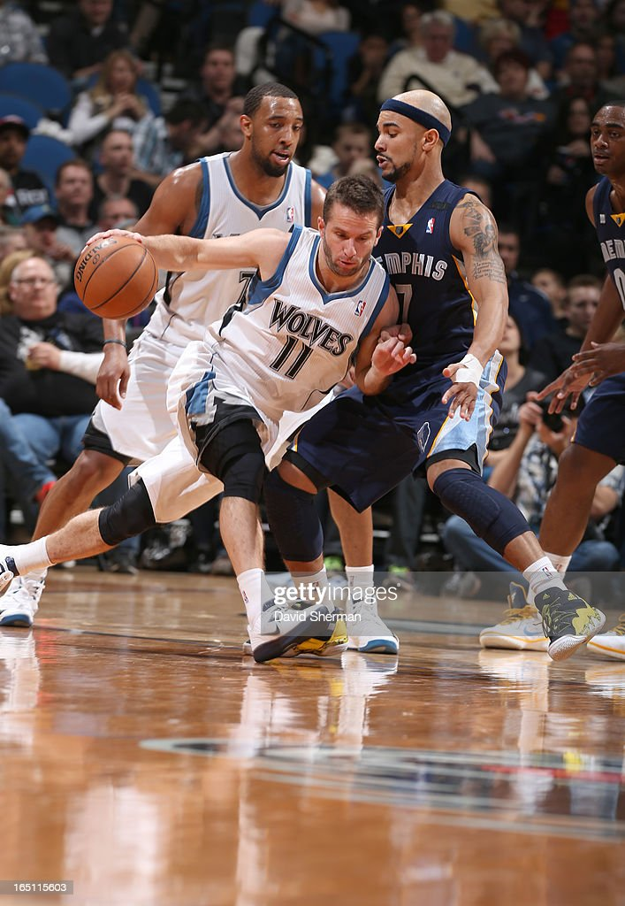 J.J. Barea #11 of the Minnesota Timberwolves drives against Jerryd Bayless #7 of the Memphis Grizzlies during the game between the Memphis Grizzlies and the Minnesota Timberwolves on March 30, 2013 at Target Center in Minneapolis, Minnesota.