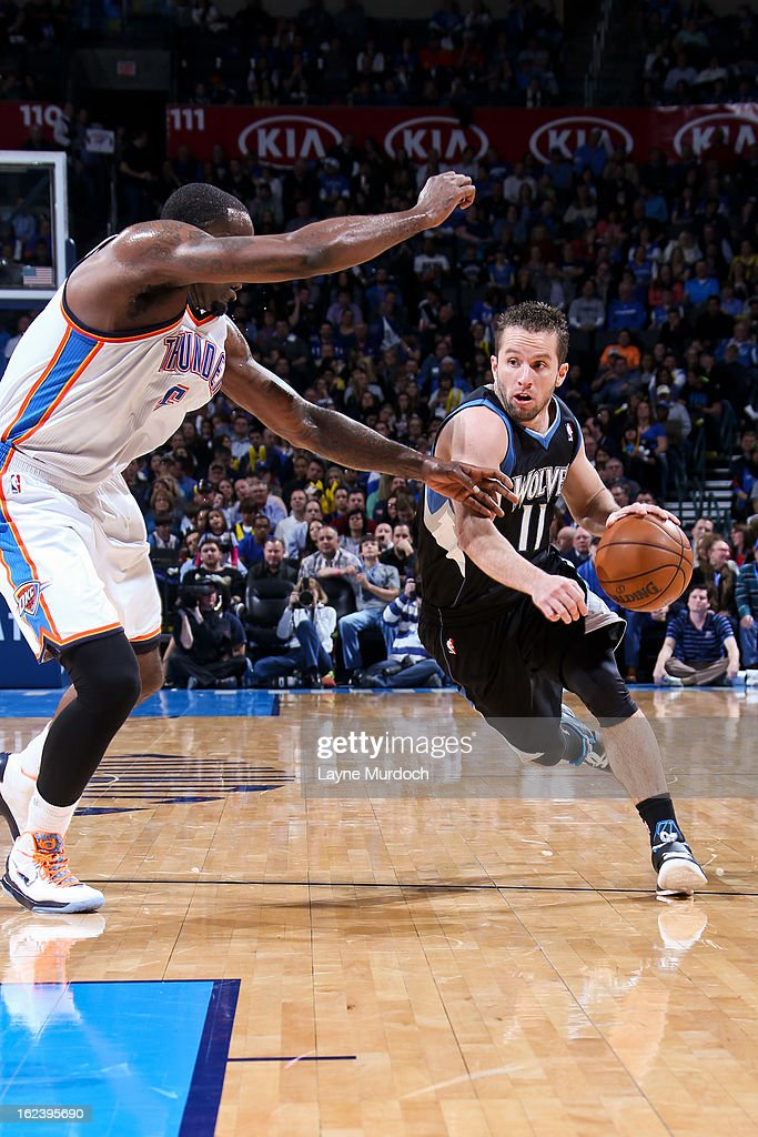 J.J. Barea #11 of the Minnesota Timberwolves drives against Kendrick Perkins #5 of the Oklahoma City Thunder on February 22, 2013 at the Chesapeake Energy Arena in Oklahoma City, Oklahoma.
