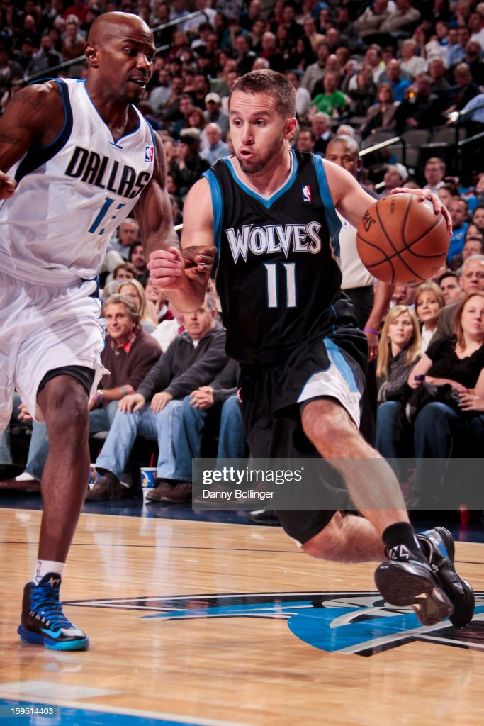 J.J. Barea #11 of the Minnesota Timberwolves drives against Mike James #13 of the Dallas Mavericks on January 14, 2013 at the American Airlines Center in Dallas, Texas.