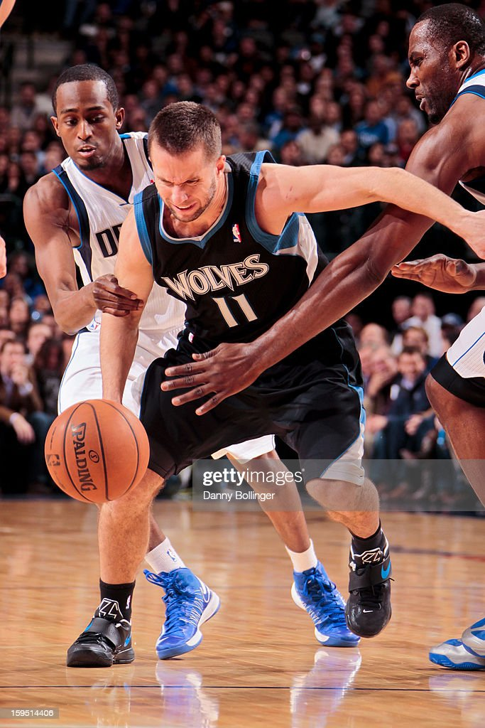J.J. Barea #11 of the Minnesota Timberwolves drives against Rodrigue Beaubois #3 and Elton Brand #42 of the Dallas Mavericks on January 14, 2013 at the American Airlines Center in Dallas, Texas.