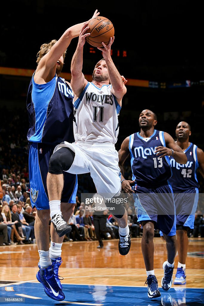 J.J. Barea #11 of the Minnesota Timberwolves drives to the basket against Dirk Nowitzki #41 of the Dallas Mavericks on March 10, 2013 at Target Center in Minneapolis, Minnesota.