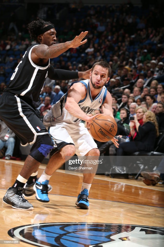 J.J. Barea #11 of the Minnesota Timberwolves drives under pressure during the game between the Minnesota Timberwolves and the Brooklyn Nets on January 23, 2013 at Target Center in Minneapolis, Minnesota.
