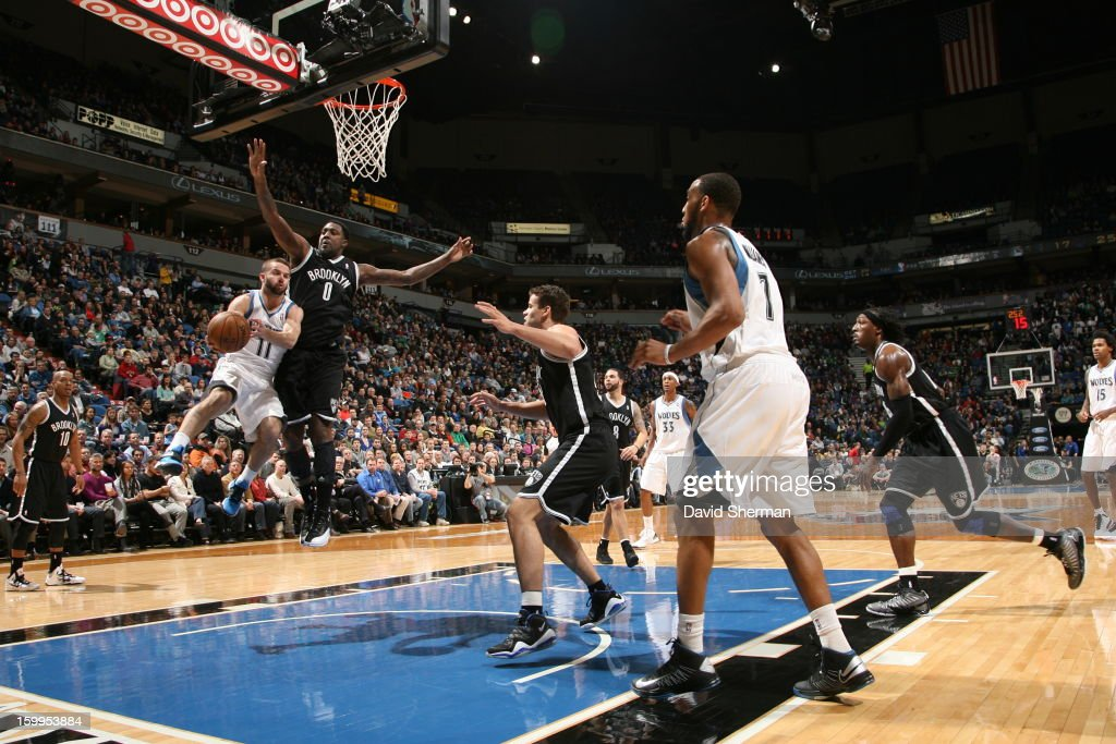 J.J. Barea #11 of the Minnesota Timberwolves goes to the basket against Andray Blatche #0 of the Brooklyn Nets during the game between the Minnesota Timberwolves and the Brooklyn Nets on January 23, 2013 at Target Center in Minneapolis, Minnesota.