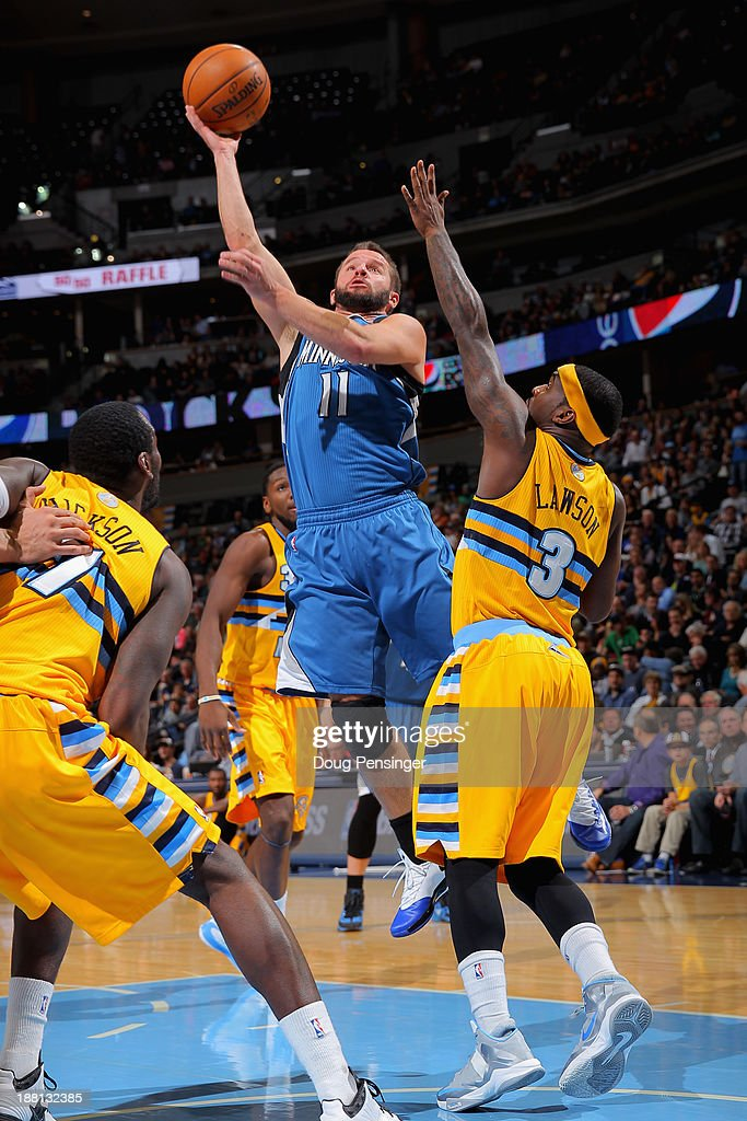 J.J. Barea #11 of the Minnesota Timberwolves lays up a shot against <a gi-track='captionPersonalityLinkClicked' href=/galleries/search?phrase=Ty+Lawson&family=editorial&specificpeople=4024882 ng-click='$event.stopPropagation()'>Ty Lawson</a> #3 of the Denver Nuggets at Pepsi Center on November 15, 2013 in Denver, Colorado.