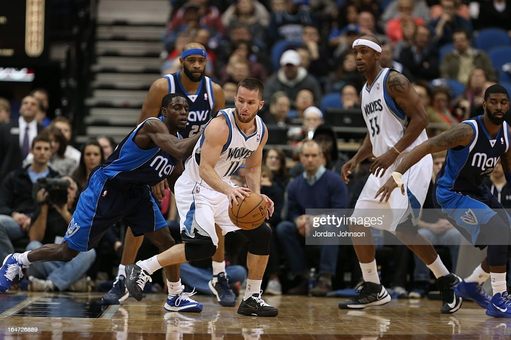 J.J. Barea #11 of the Minnesota Timberwolves looks to pass the ball against the Dallas Mavericks on March 10, 2013 at Target Center in Minneapolis, Minnesota.