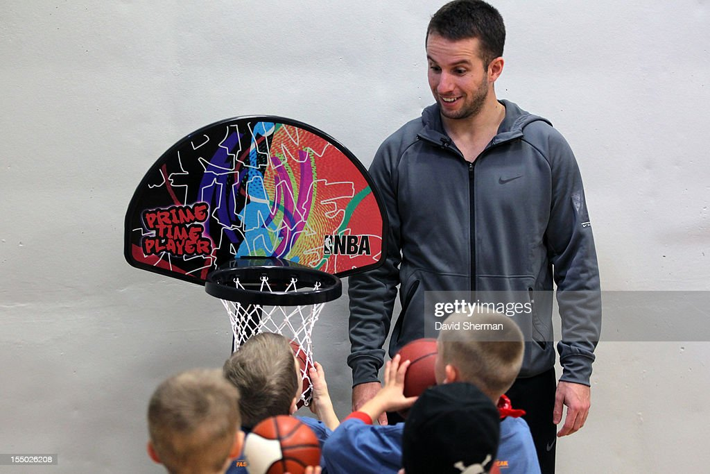 J.J. Barea of the Minnesota Timberwolves plays basketball with kids after dedicating a refurbished basketball court on October 30, 2012 at the Ronald McDonald House - Oak Street in Minneapolis, Minnesota.