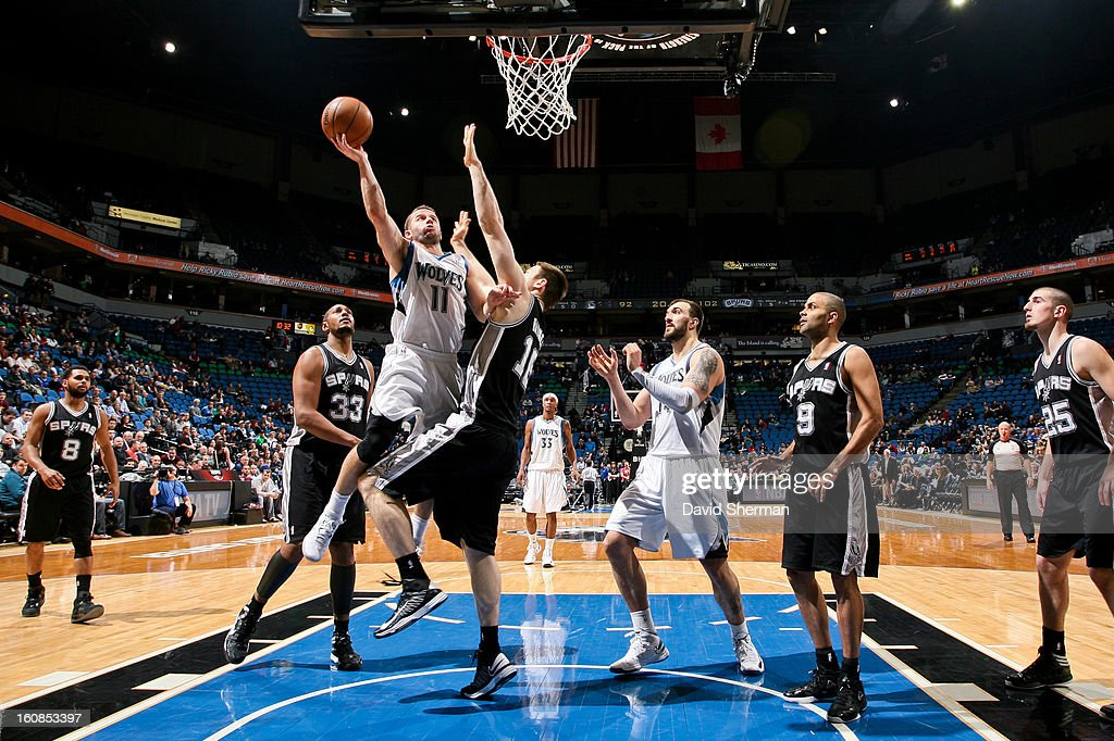 J.J. Barea #11 of the Minnesota Timberwolves shoots a layup against Aron Baynes #16 of the San Antonio Spurs on February 6, 2013 at Target Center in Minneapolis, Minnesota.