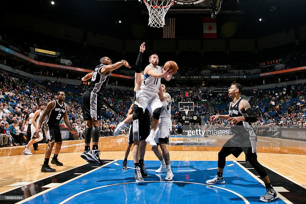 J.J. Barea #11 of the Minnesota Timberwolves shoots a layup against Boris Diaw #33 of the San Antonio Spurs on February 6, 2013 at Target Center in Minneapolis, Minnesota.