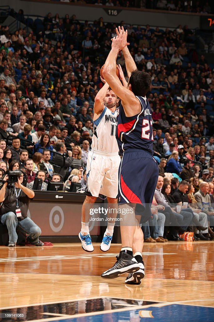 J.J. Barea #11 of the Minnesota Timberwolves shoots a three point shot against Zaza Pachulia #27 of the Atlanta Hawks during the game on January 8, 2013 at Target Center in Minneapolis, Minnesota.