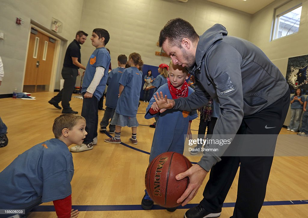 JJ Barea of the Minnesota Timberwolves shows the finer points of ball control after dedicating a refurbished basketball court on October 30, 2012 at the Ronald McDonald House - Oak Street in Minneapolis, Minnesota.