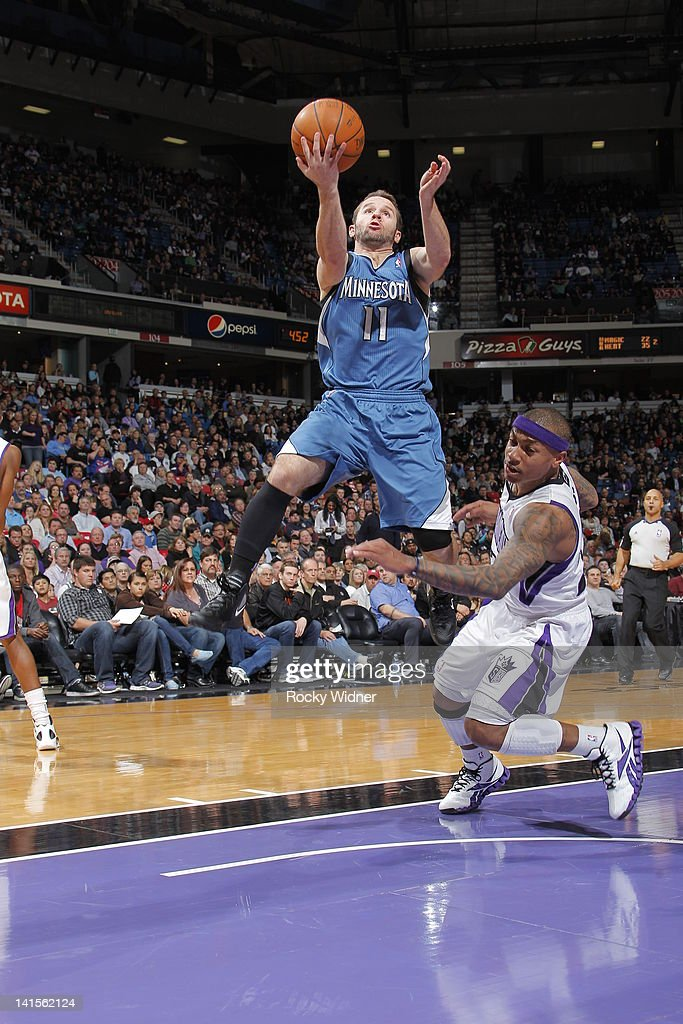J.J. Barea #11 of the Minnesota Timberwolves takes the ball to the basket past Isaiah Thomas #22 of the Sacramento Kings on March 18, 2012 at Power Balance Pavilion in Sacramento, California.