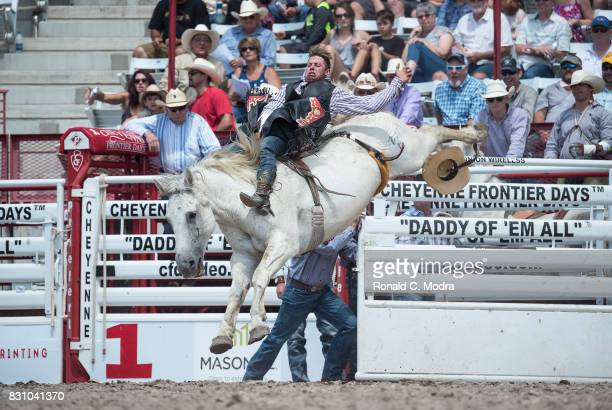 Bareback rider Joe Wilson rides during the Frontier Days Rodeo on July 23 2017 in Cheyenne Wyoming