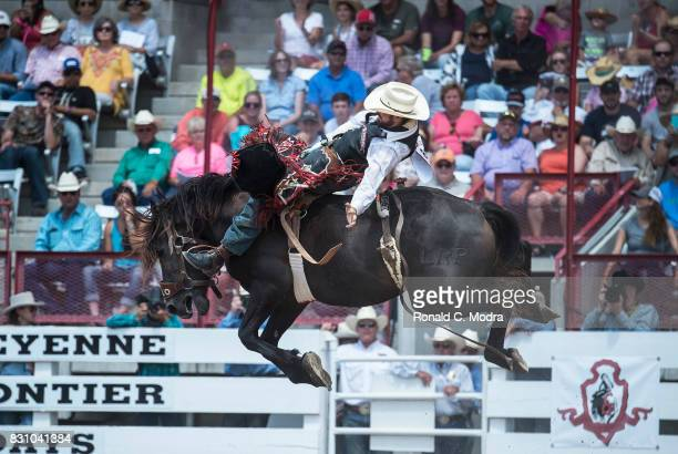 Bareback rider Logan Patterson rides during the Frontier Days Rodeo on July 23 2017 in Cheyenne Wyoming