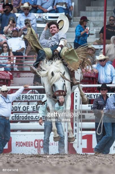 Bareback rider Weston Garrett rides during the Frontier Days Rodeo on July 23 2017 in Cheyenne Wyoming