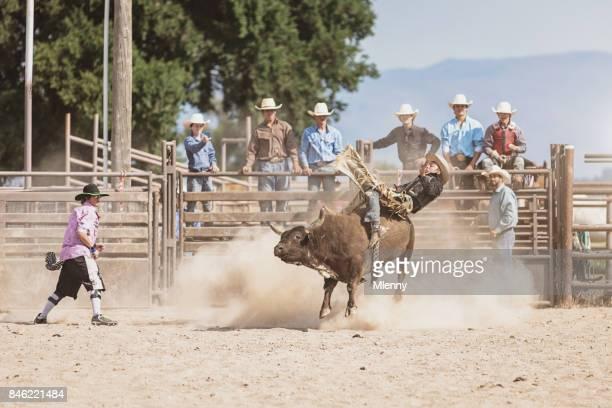 Bareback Riding Cowboy Falling From Raging Bucking Bull