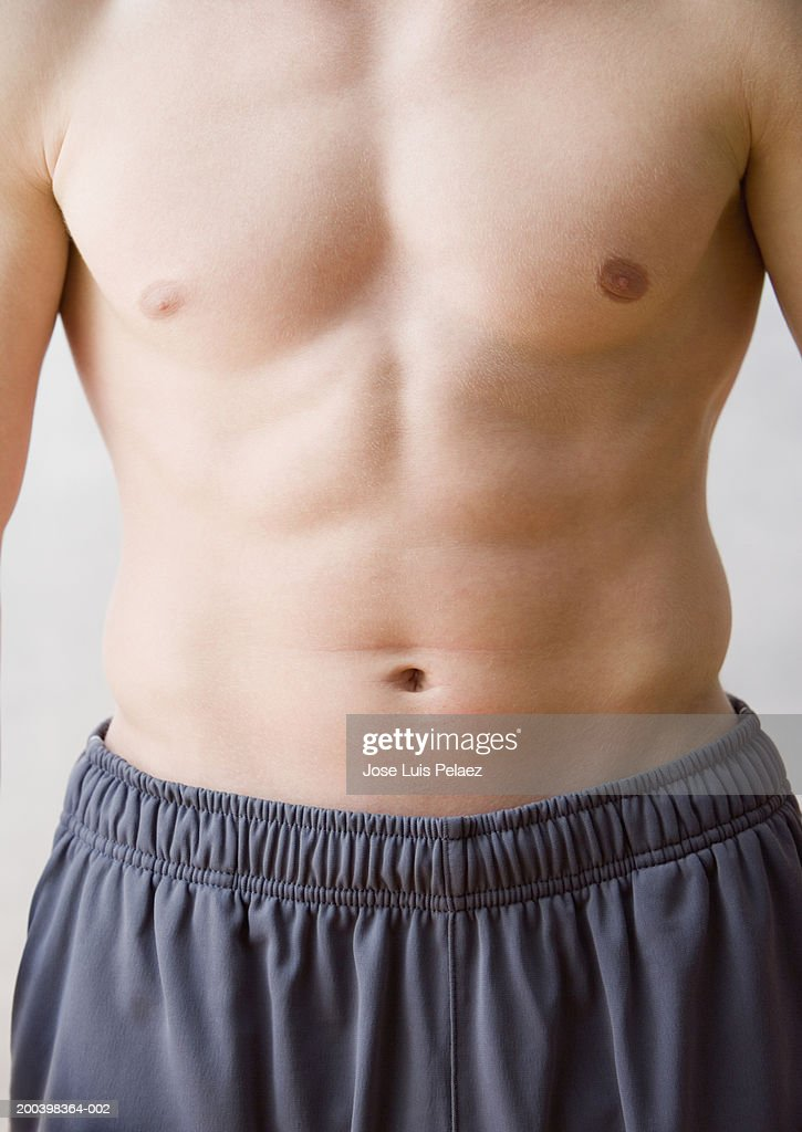 Barechested man, mid-section, close-up : Stock Photo