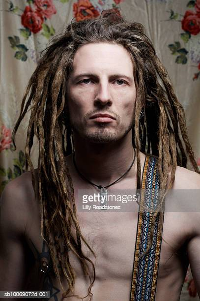 Barechested man with dreadlocks, close-up, portrait