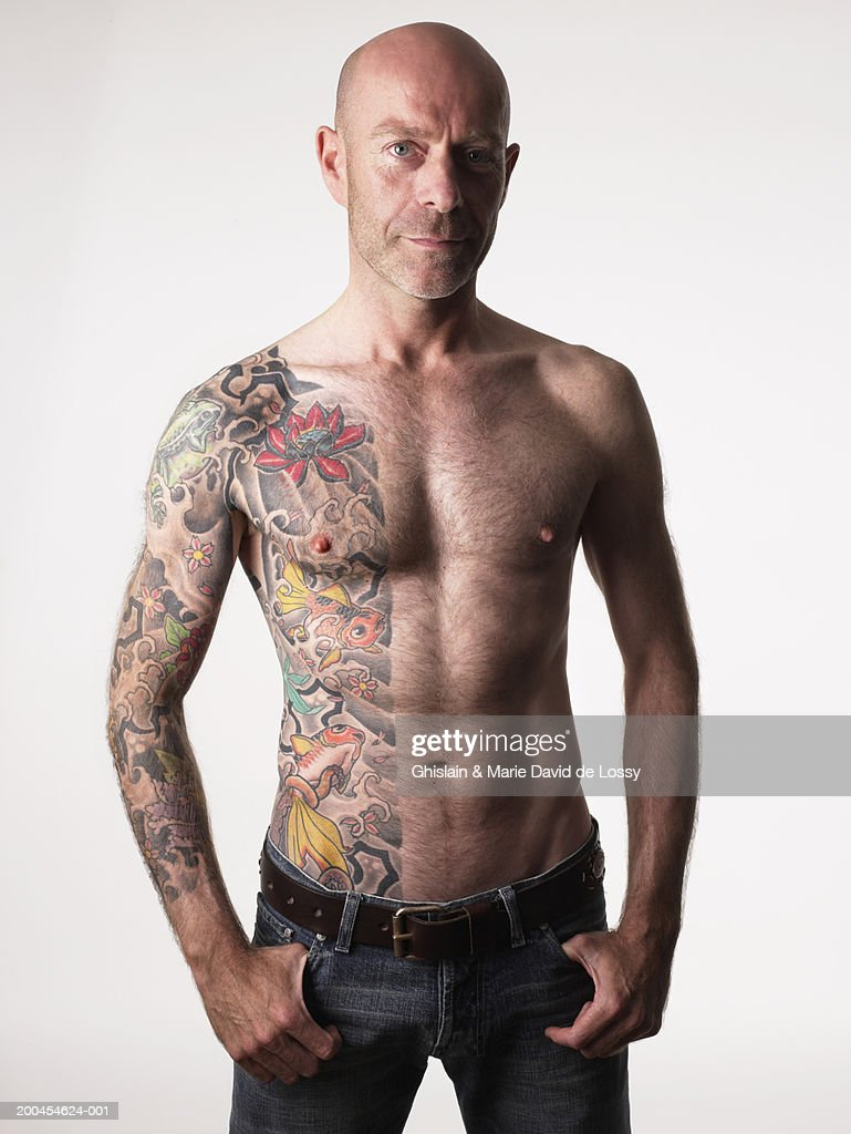Barechested man with tattoo, portrait : Stock Photo