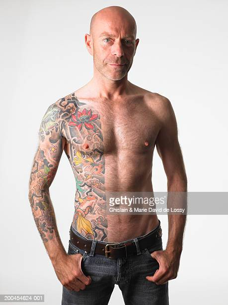 Barechested man with tattoo, portrait
