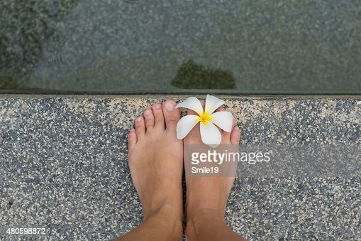 Bared feet with flower : Stock Photo