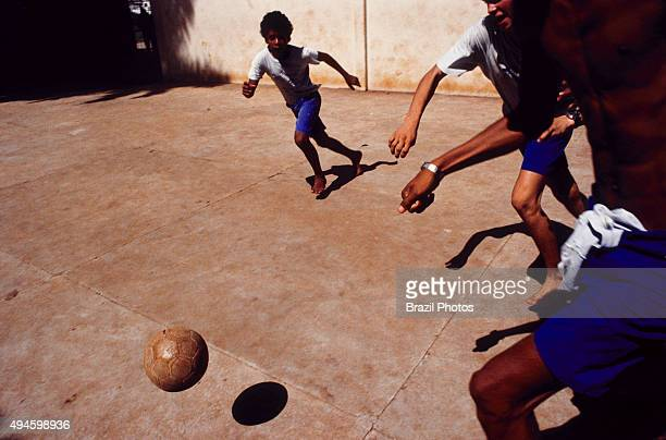 Barefoot boys play soccer in the street Rio de Janeiro Brazil
