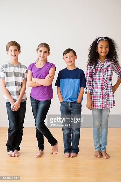 Barefoot children smiling in studio