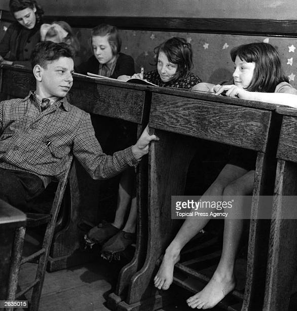 A barefoot girl and her classmates in a Lancashire school Original Publication Picture Post 5407 Sex and the Citizen pub 1951