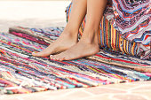 Barefoot legs of carefree woman relaxing