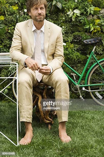 Barefoot man wearing suit