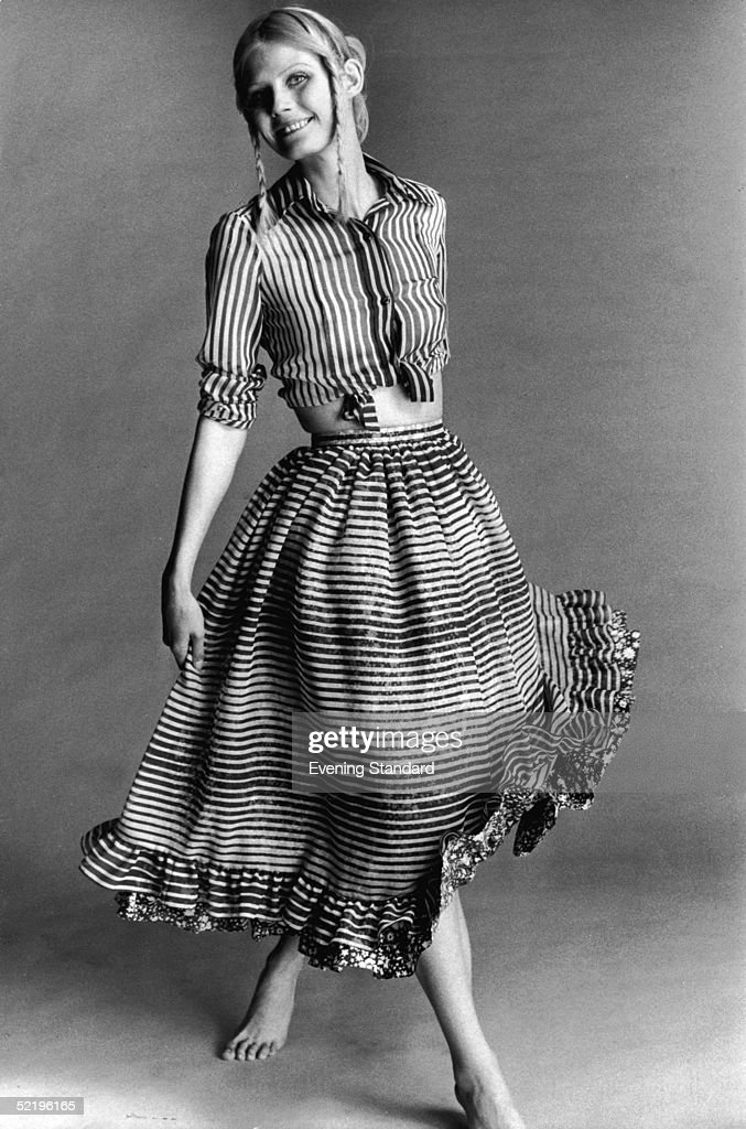 A barefoot model wearing a striped skirt and matching blouse March 1970