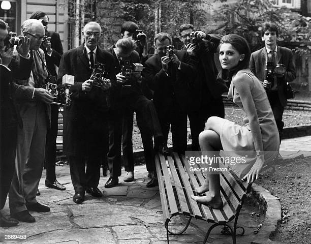 Barefoot singer Sandie Shaw faces the pressmen's cameras after the announcement that she is to sing Britain's entry into the Eurovision Song Contest...