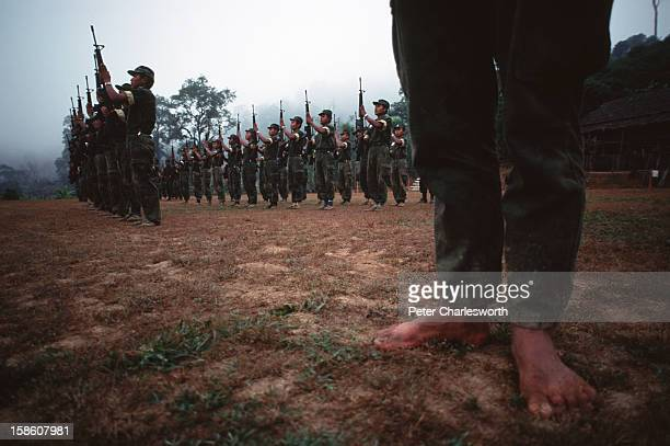 Barefoot soldiers of the Karen National Liberation Army on early morning parade in their Manerplaw stronghold on the banks of the Salween River on...