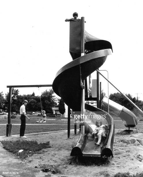 A barefoot tot comes down slide at newly completed mini Park Credit The Denver Post