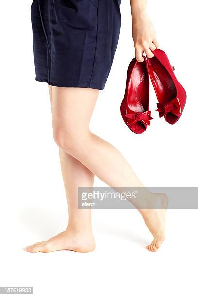 Barefoot Woman Walking With Red Shoes