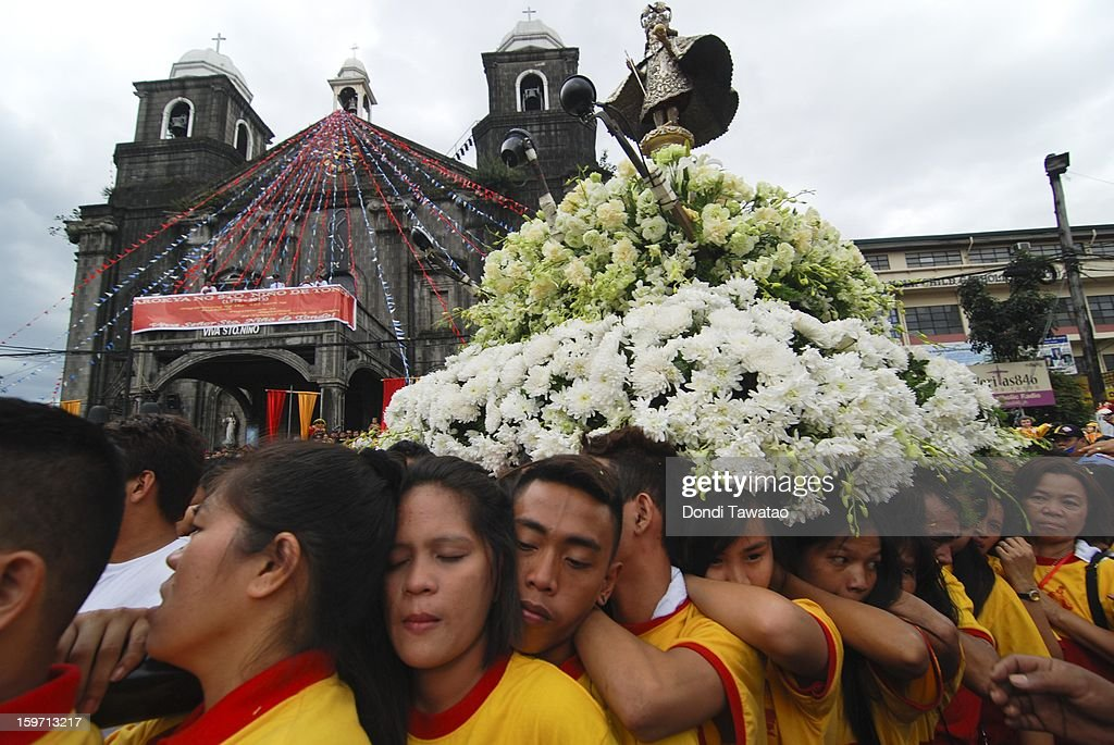 Barefooted Catholic devotees carry the centuries-old image of the Santo Nino during the feast of Santo Nino and the grand procession of various images of the Child Jesus in the working class district of Tondo on January 19, 2013 in Manila, Philippines. The annual Catholic celebration signals the start of festivities in various parts of the Philippines.