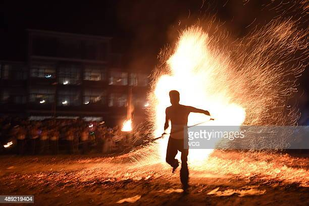 A barefooted man performs Fire Walking around the burning charcoal on September 18 2015 in Pan'an County Jinhua City Zhejiang Province of China 27...