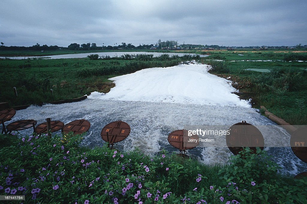 Barely treated sewage pours from a sewage canal into wetlands and fields on the southern edge of Phnom Penh. Much of the food that feeds the capital is grown in this area. The city's storm and sewer system dates from French colonial days and is severely over-taxed..